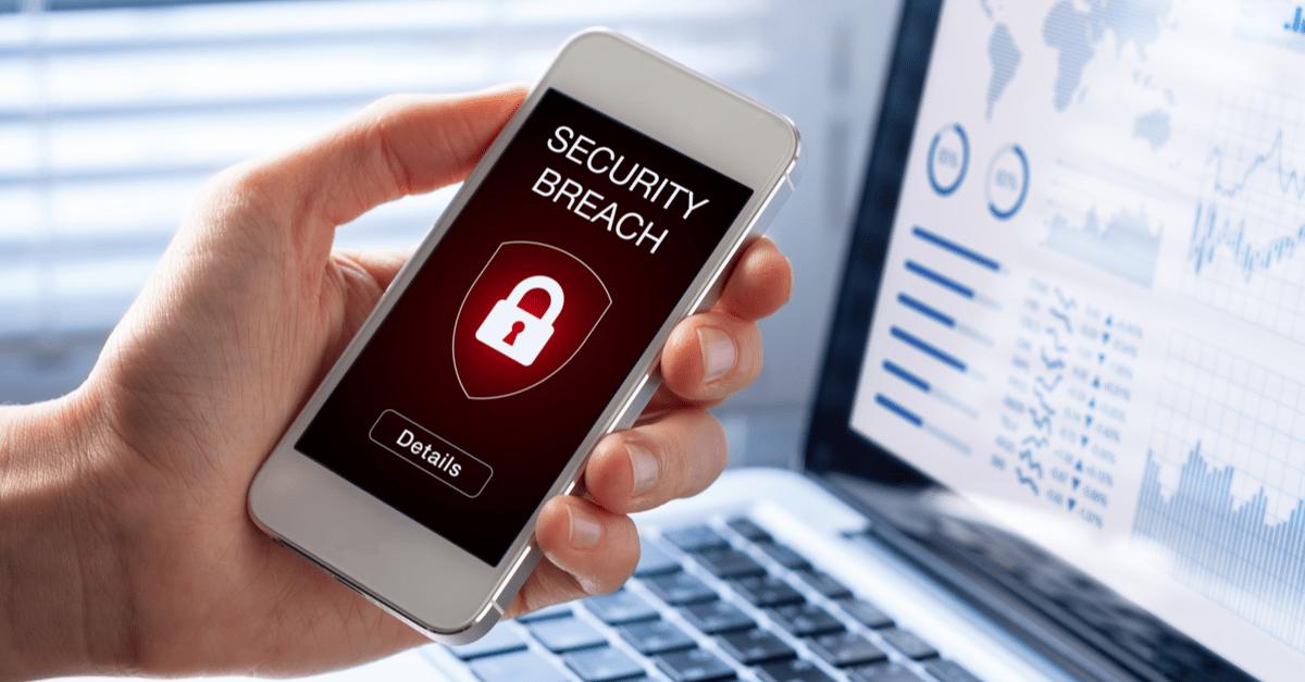 a phone showing a security breach alert